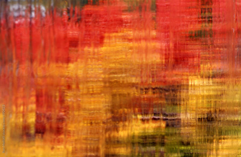 time exposure telephoto of flowing water reflecting autumn colors in New Hampshire by Ron Mellott for Stocksy United
