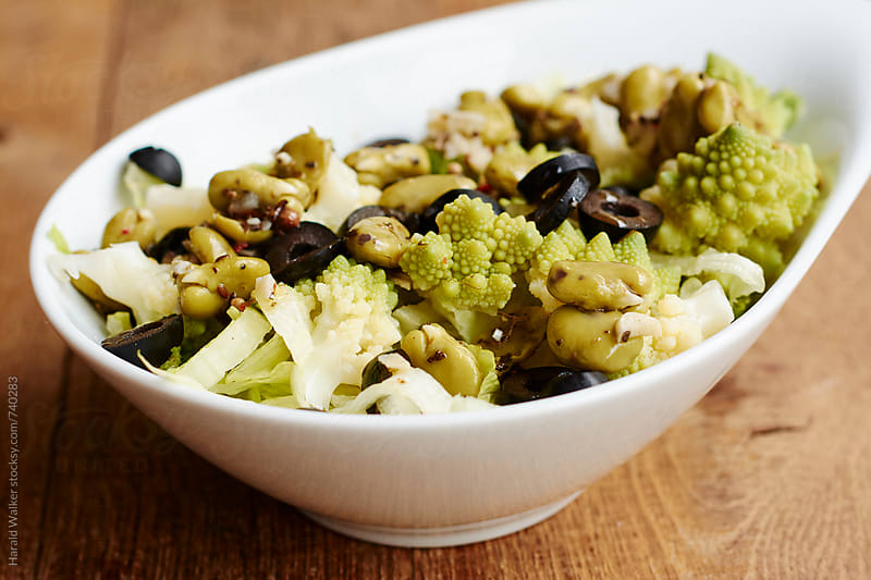 Marinated fava beans with romanesco and olives by Harald Walker for Stocksy United