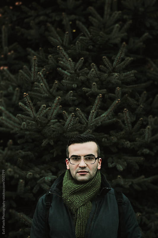 Portrait of a handsome male model in winter clothes  by Evil Pixels Photography for Stocksy United