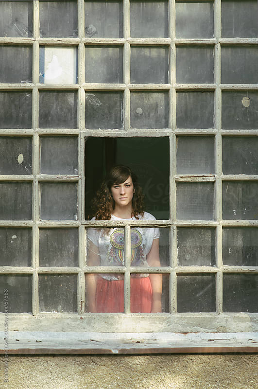 Portrait Of a Beautiful Woman Through the Window by Brkati Krokodil for Stocksy United