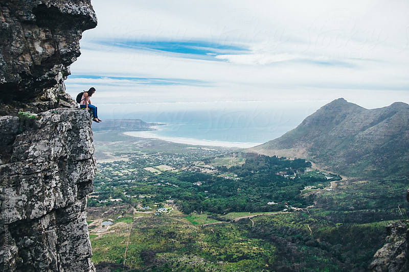 Hiker standing on the edge of a cliff looking at the view by Micky Wiswedel for Stocksy United