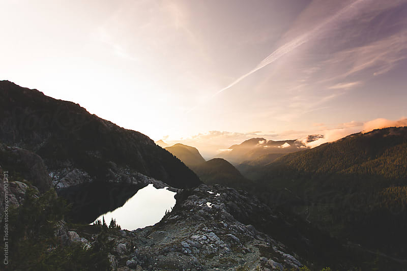 Alpine lake during sunset in the pacific northwest by Christian Tisdale for Stocksy United