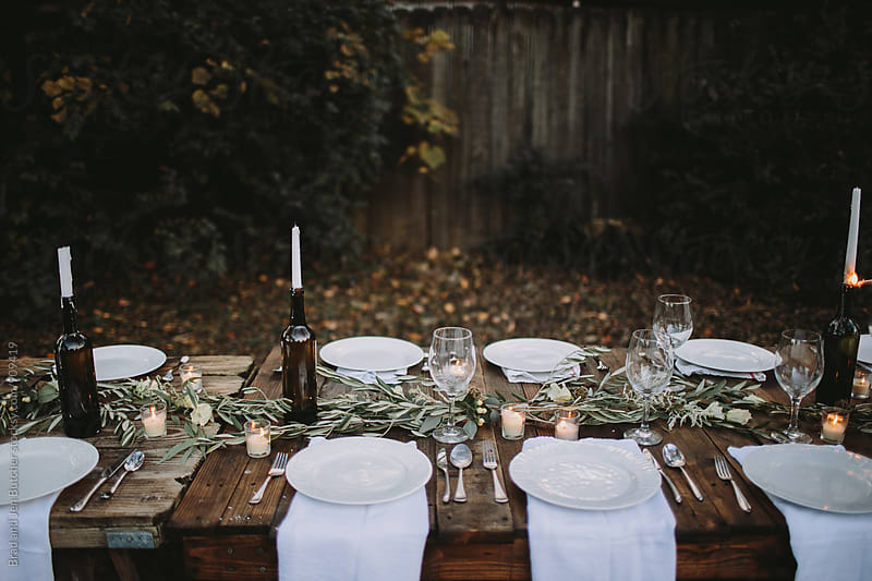 Backyard Dinner Tablescape by Brad and Jen Butcher for Stocksy United