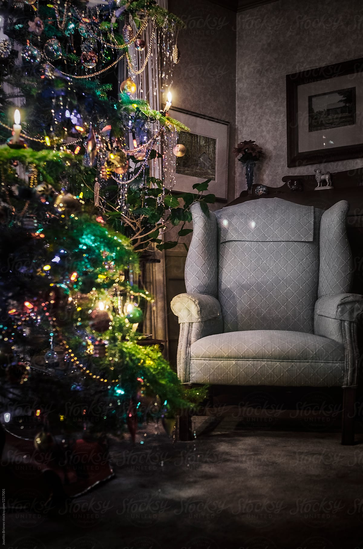 Armchair And Christmas Tree Decorated And Lighted With