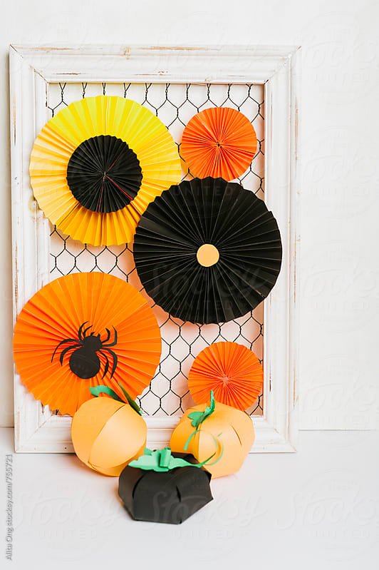 Halloween rosettes on frame by Alita Ong for Stocksy United
