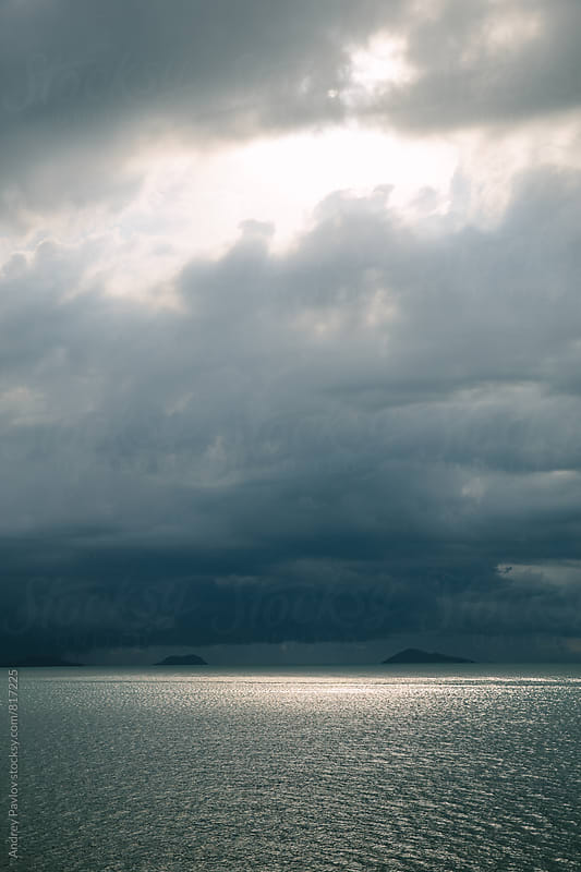 Stormy sky and path of sunlight on sea surface by Andrey Pavlov for Stocksy United