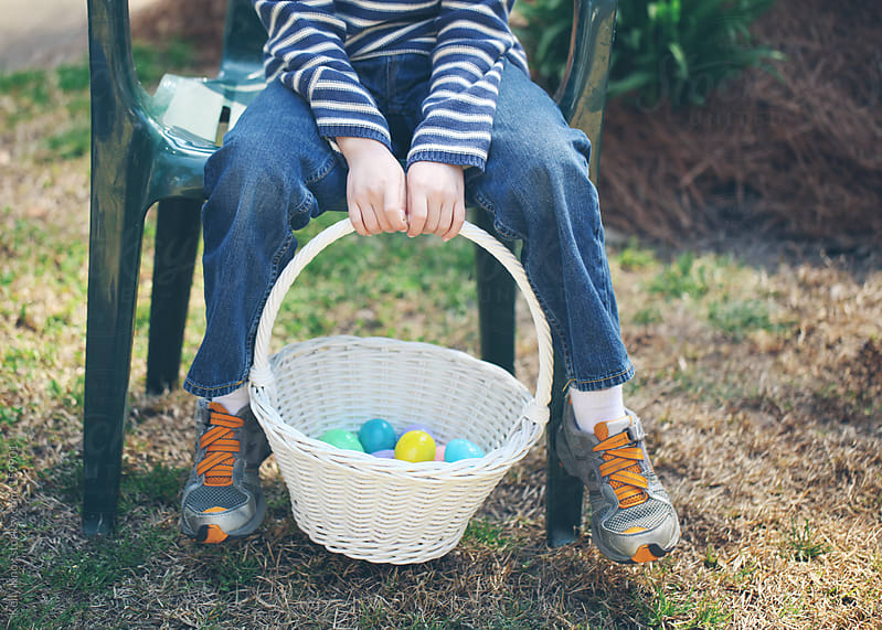 child holding easter eggs in a basket by Kelly Knox for Stocksy United