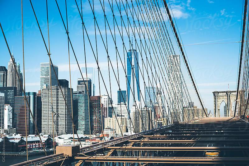 Taxi on Brooklyn Bridge against New York City skyline by GIC for Stocksy United
