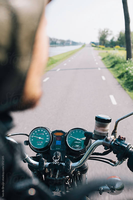 Overview / Point of view of a rider or motorcyclist on his classic motor while riding by Ivo de Bruijn for Stocksy United