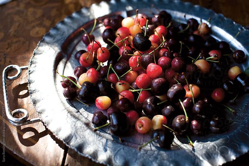 Organic Cherries on a Silver Platter by Sara Remington for Stocksy United