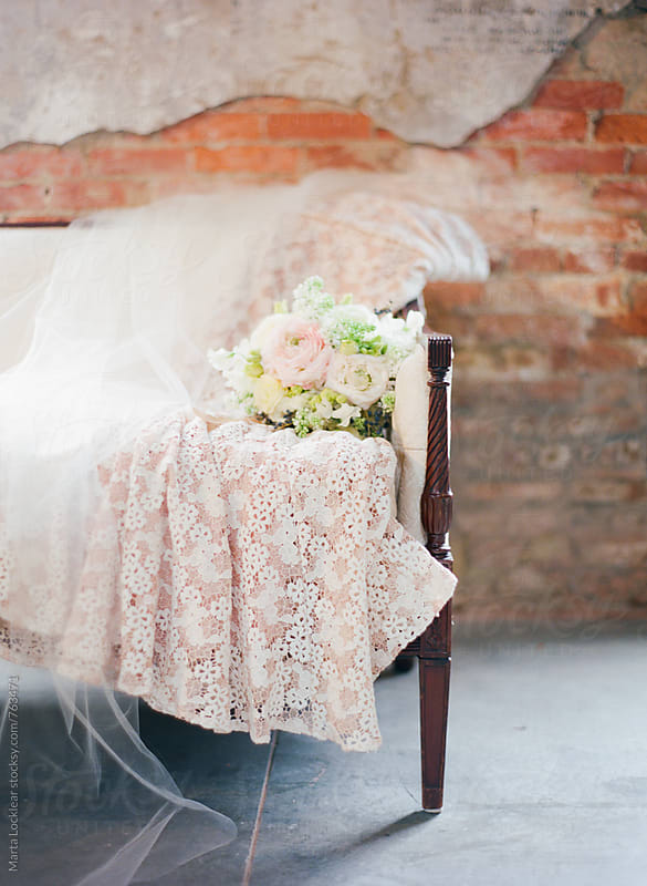 Pink wedding gown, veil and bouquet by Marta Locklear for Stocksy United