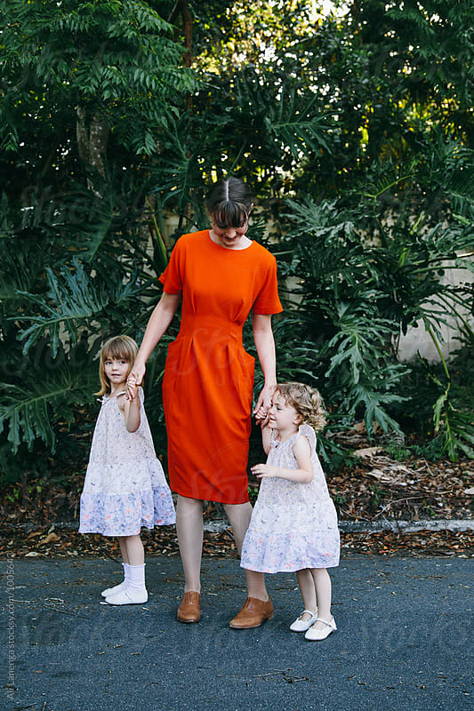 Mother and daughters by Ali Lanenga for Stocksy United