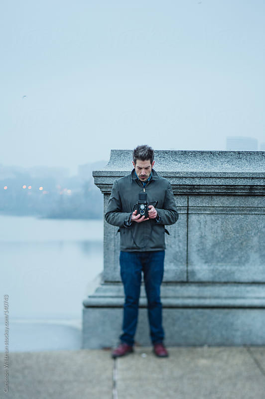 Photographer shooting outdoors in Washington DC by Cameron Whitman for Stocksy United