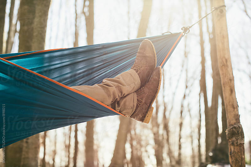 Closeup of a man sleeping on hammock in the forest. by BONNINSTUDIO for Stocksy United