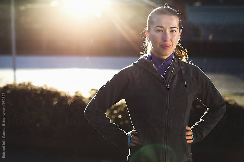 Portrait of young, healthy caucasian woman in running gear outside by Rob and Julia Campbell for Stocksy United