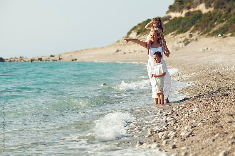 Family on the beach by Dejan Ristovski for Stocksy United