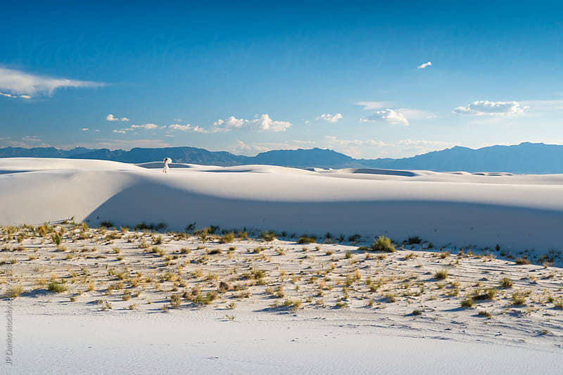 Woman With Umbrella and Sand Dunes In White Sands National Monumant New Mexico with Vibrant Blue Sky by JP Danko for Stocksy United
