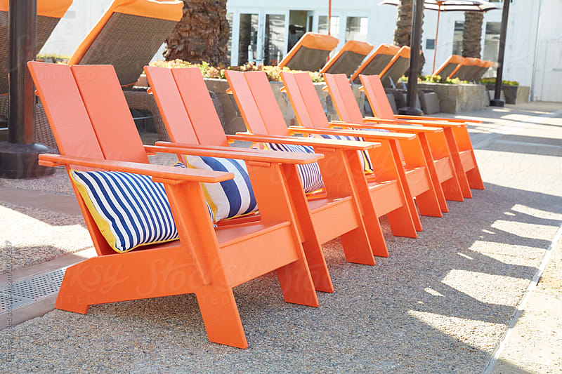Small kid lounge chairs at kiddie pool at luxury resort by Trinette Reed for Stocksy United