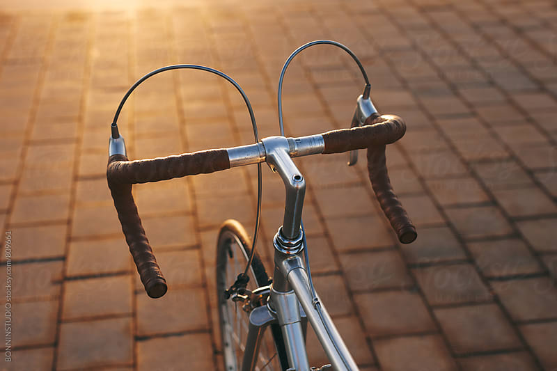 Leather handlebar in a vintage bicycle on the street. by BONNINSTUDIO for Stocksy United