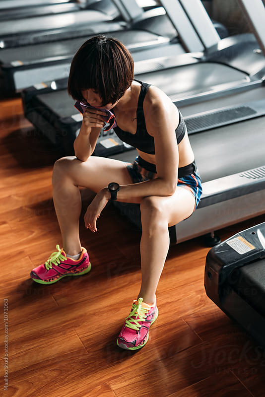 Young woman resting from exercising at gym by Maa Hoo for Stocksy United