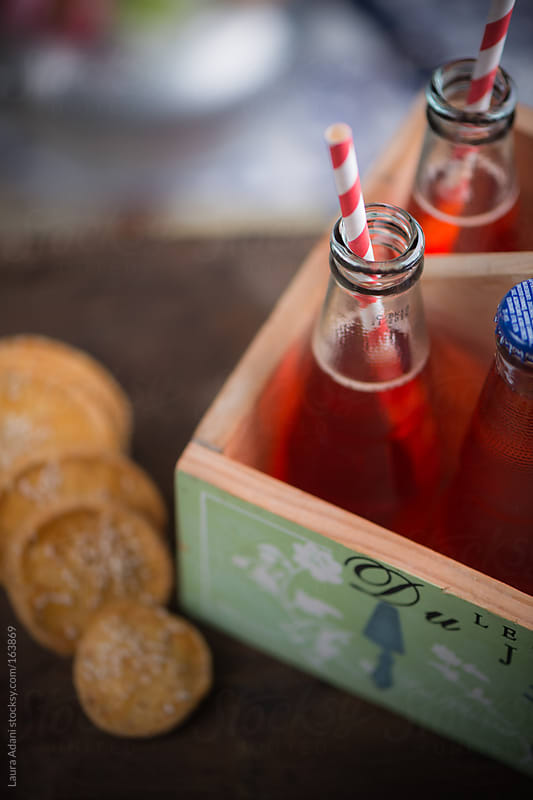 aperol  as aperitif  in a bottle with drinking straw by Laura Adani for Stocksy United