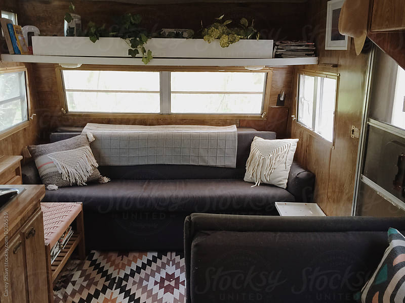 Inside of vintage trailer with modern furnishings by Carey Shaw for Stocksy United