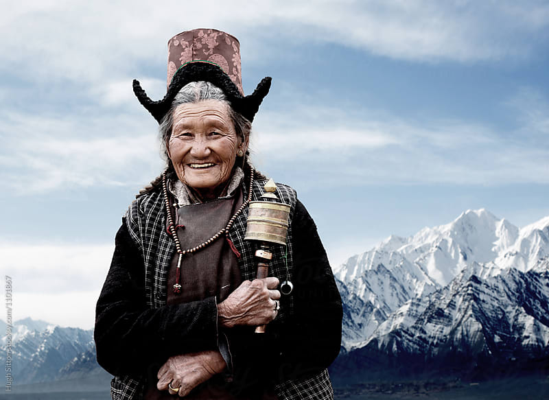 Traditional woman holding prayer wheel. Ladakh. India by Hugh Sitton for Stocksy United