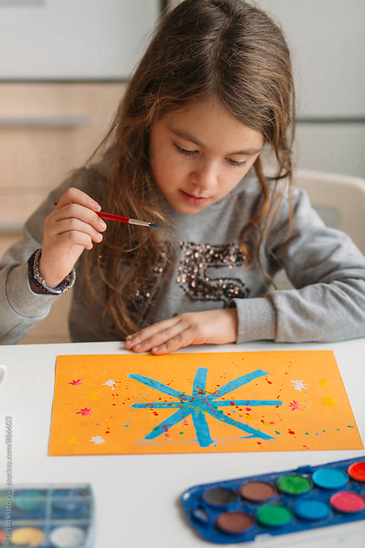 Child painting at home. by Dejan Ristovski for Stocksy United