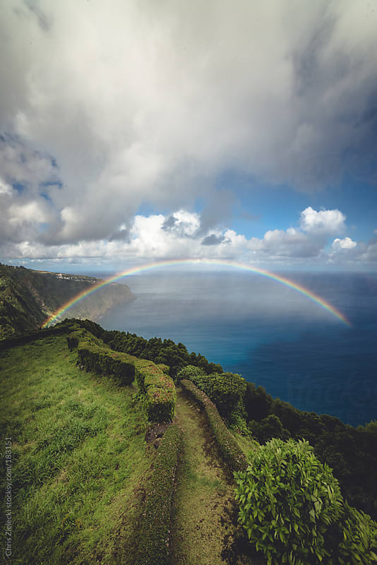 Rainbow at the end of a path at the coast by Christian Zielecki for Stocksy United