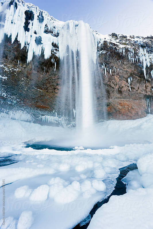 Iceland, Seljalandfoss Falls, waterfall and cliff, Rangarvalla District by Gavin Hellier for Stocksy United