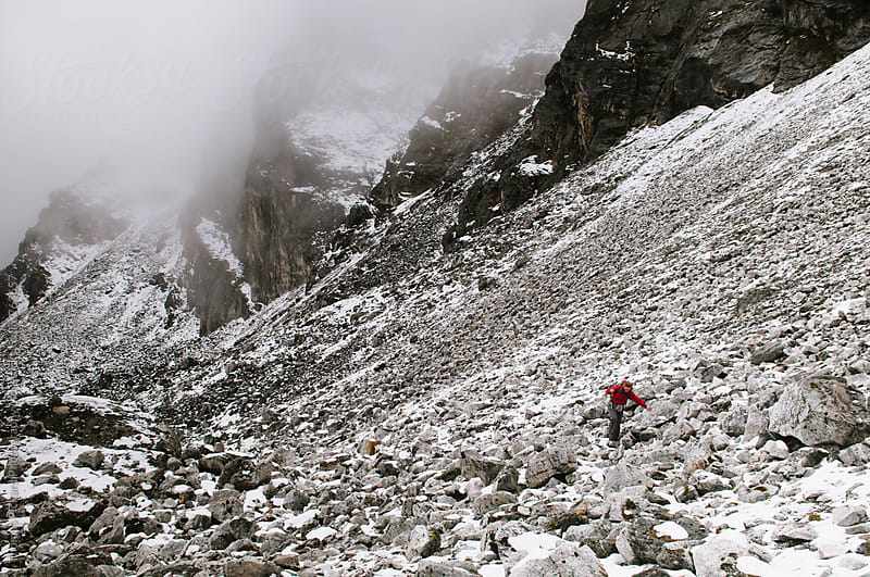 Female trekker climbing loose scree while climbing an alternate route to Kongma La Pass, Everest Region, Sagarmatha National Park, Nepal. by Thomas Pickard Photography Ltd. for Stocksy United