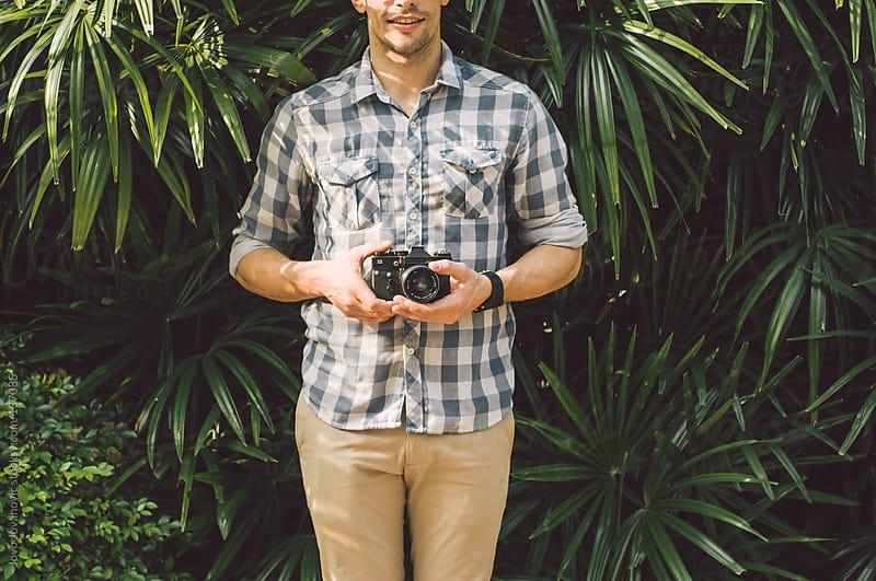 Man holding a vintage camera. by Jovo Jovanovic for Stocksy United