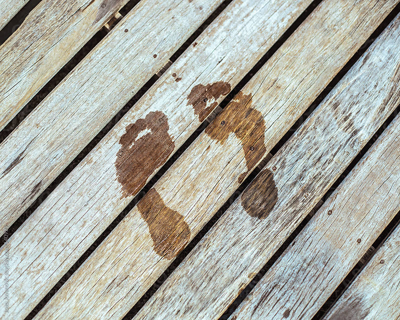 Wet footprint on wooden surface by Jovo Jovanovic for Stocksy United