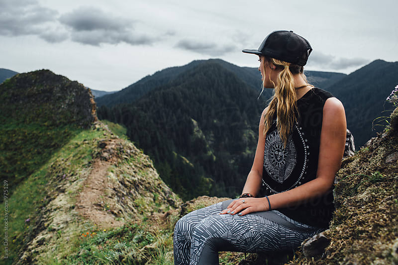 Woman Hiker Sitting on Mountain Cliff by Evan Dalen for Stocksy United