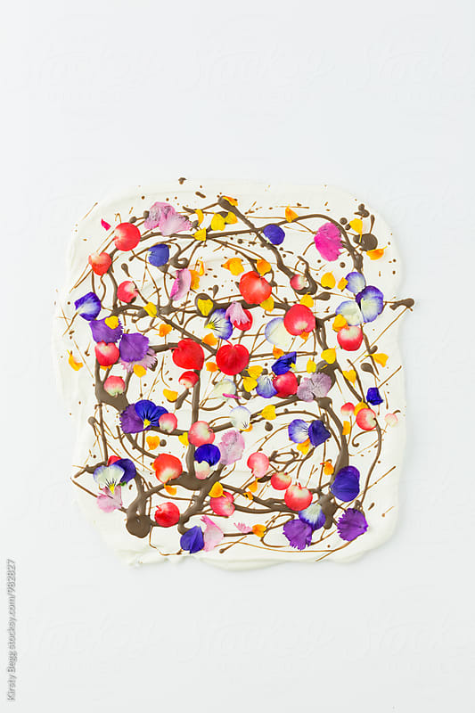 Sheet of gourmet chocolate decorated with edible flowers by Kirsty Begg for Stocksy United