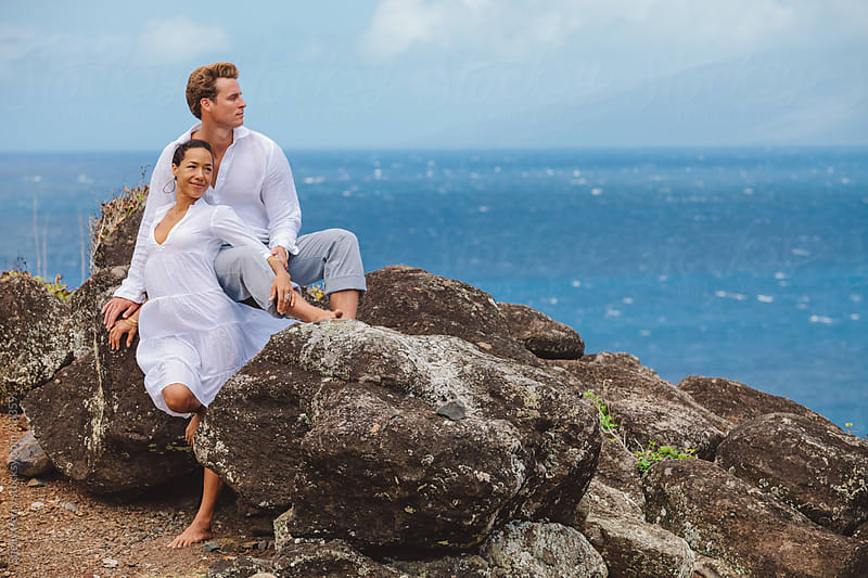 Portrait of a Relaxed Couple Above the Ocean on Vacation by Shelly Perry for Stocksy United