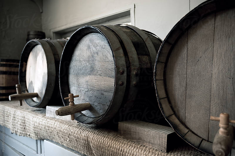 Old wooden beer barrels by Paul Phillips for Stocksy United