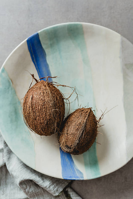 Artistic ceramic plate with coconuts by Tatjana Zlatkovic for Stocksy United
