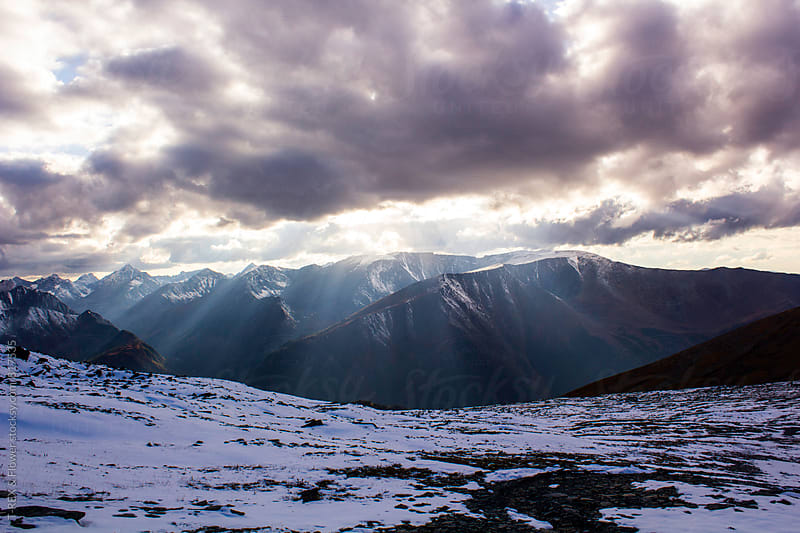 Picturesque view of mountains covered with snow and clouds by Danil Nevsky for Stocksy United