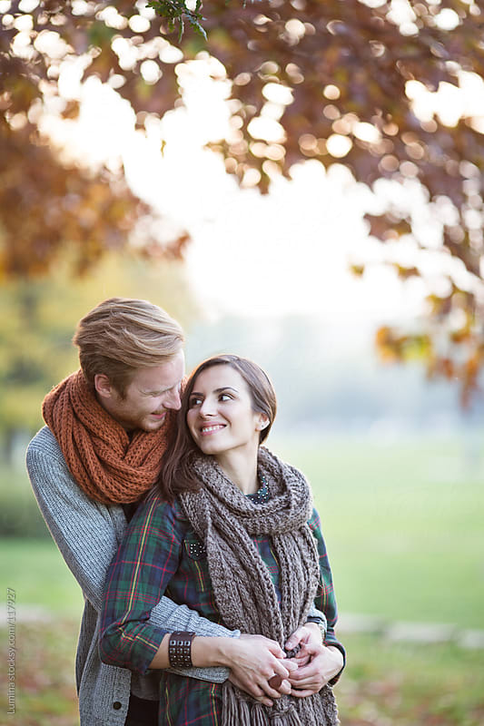 Couple Outdoors on an Autumn Day by Lumina for Stocksy United