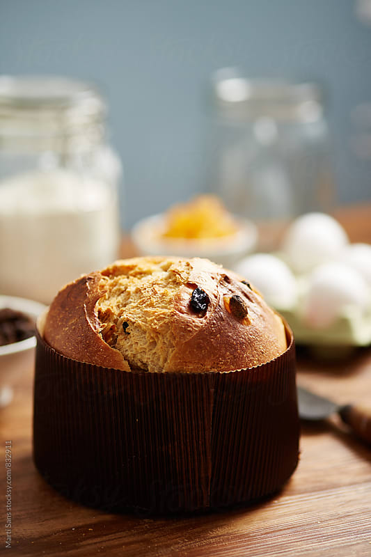 Baked panettone with raisins and candied orange in cake pan by Martí Sans for Stocksy United