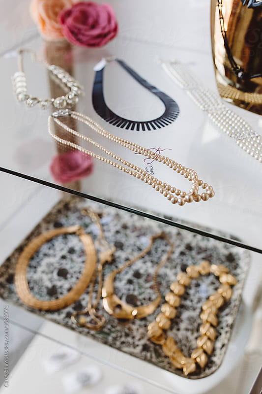 Vintage jewelry on display in cute boutique shop by Carey Shaw for Stocksy United