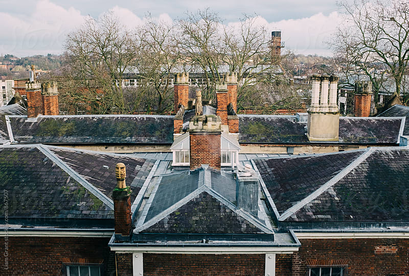 Old rooftop and chimneys. Norwich, Norfolk, UK. by Liam Grant for Stocksy United