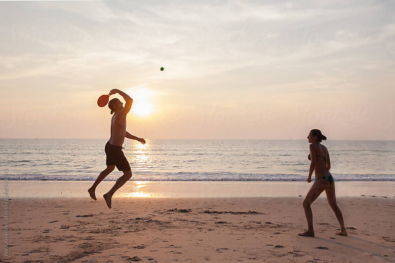Friends playing at the beach by Jovo Jovanovic for Stocksy United
