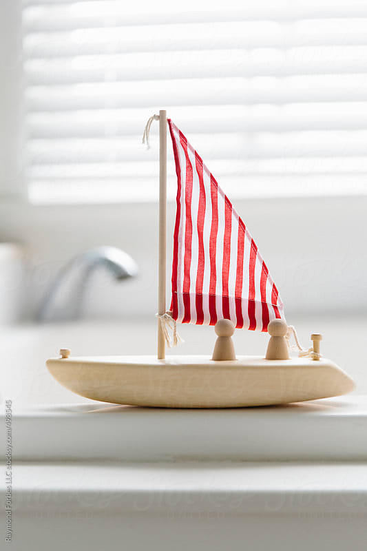 Toy Boat For Bath Time by Raymond Forbes LLC for Stocksy United