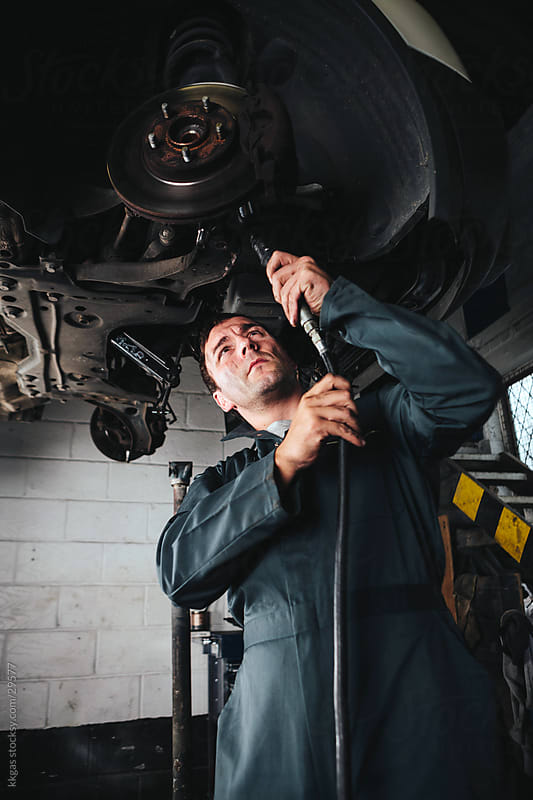 Mechanic working on car. by kkgas for Stocksy United