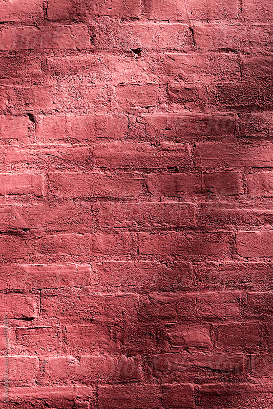 Red brick wall with shadows by Melanie Kintz for Stocksy United