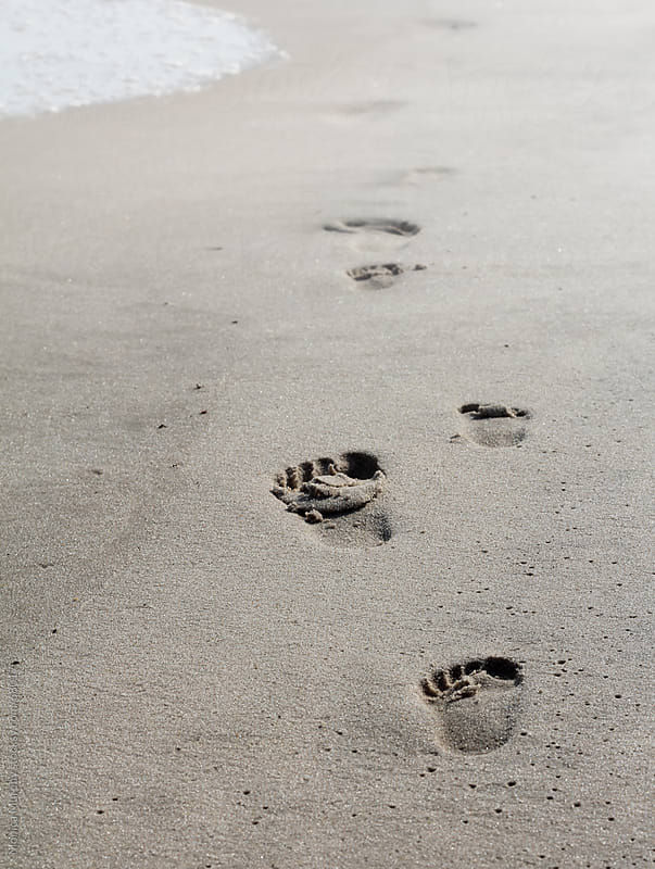Footsteps in the sand by Monica Murphy for Stocksy United