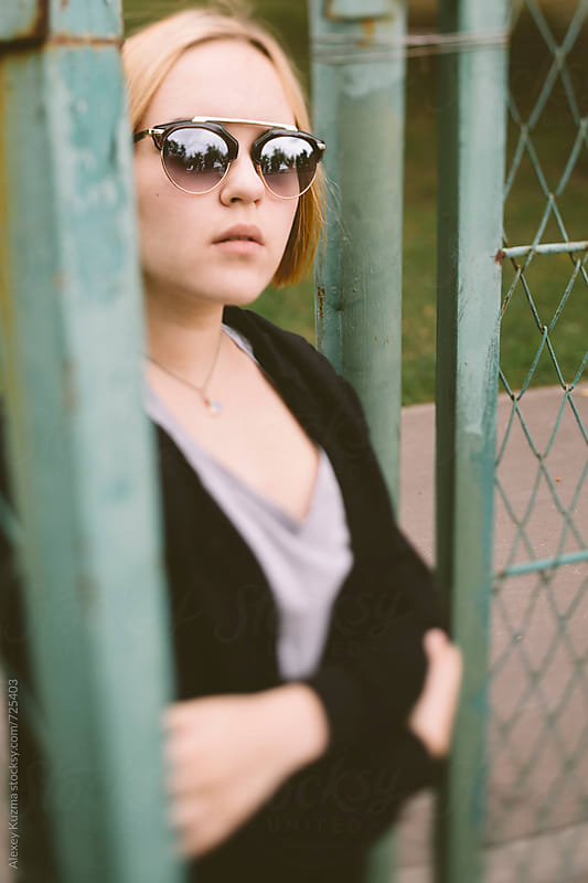 portrait of real young woman with sunglasses by Vesna for Stocksy United