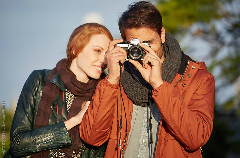 Woman With Man Using Camera To Take Picture by ALTO IMAGES for Stocksy United
